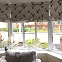 Handmade pattern matched Roman Blinds in a Bay Window
