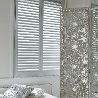 Create a beautiful living space with stylish shutters