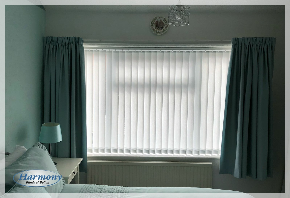Beautiful Teal Bedroom Decor finished with Vertical Blinds and Curtains