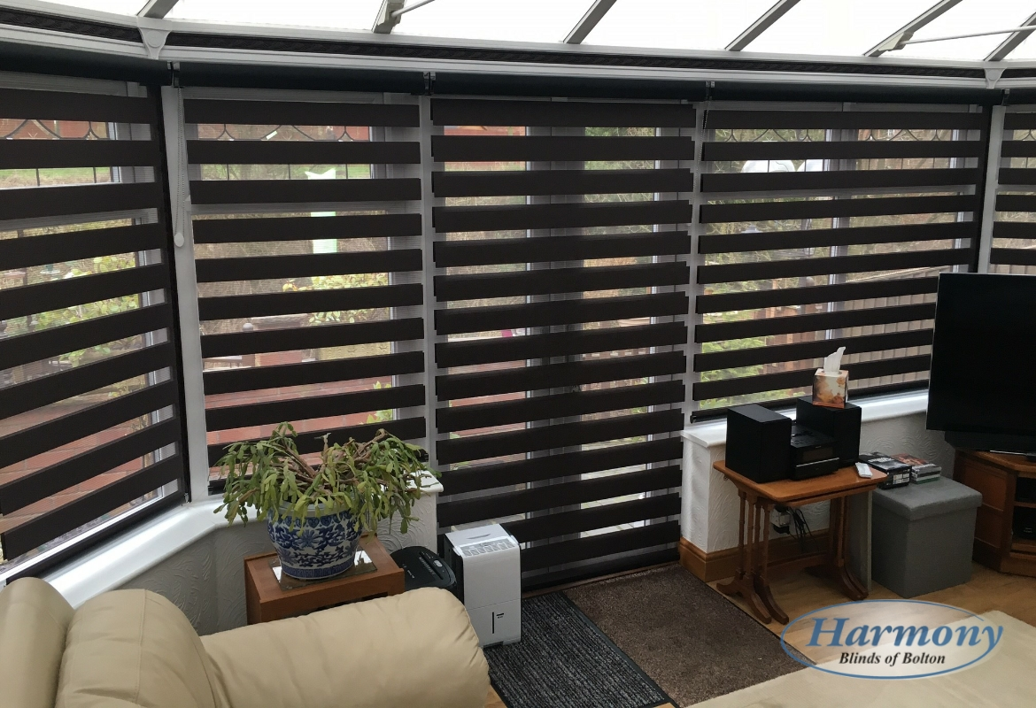 Black Mirage Day And Night Blinds In A Conservatory Open