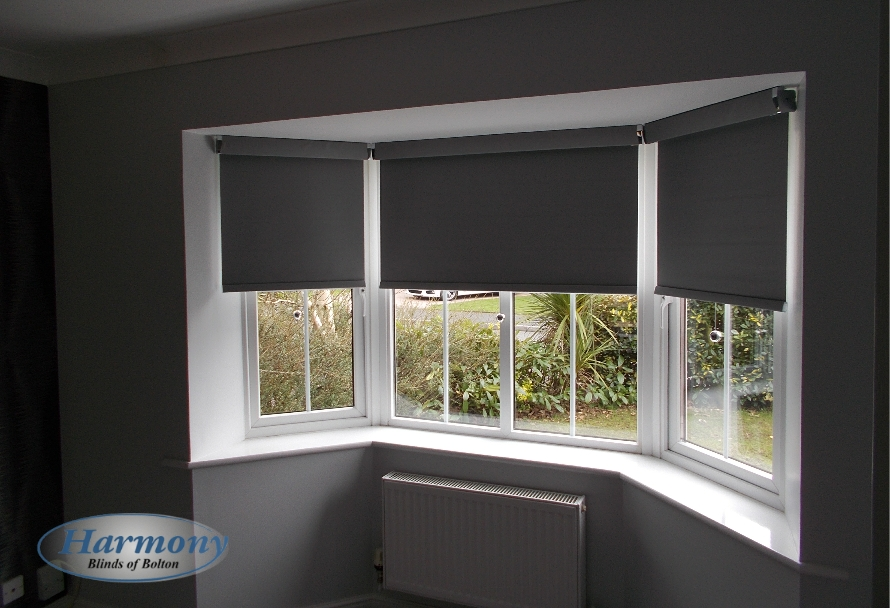 Grey Senses Roller Blinds With Chrome Finishes In A Bay