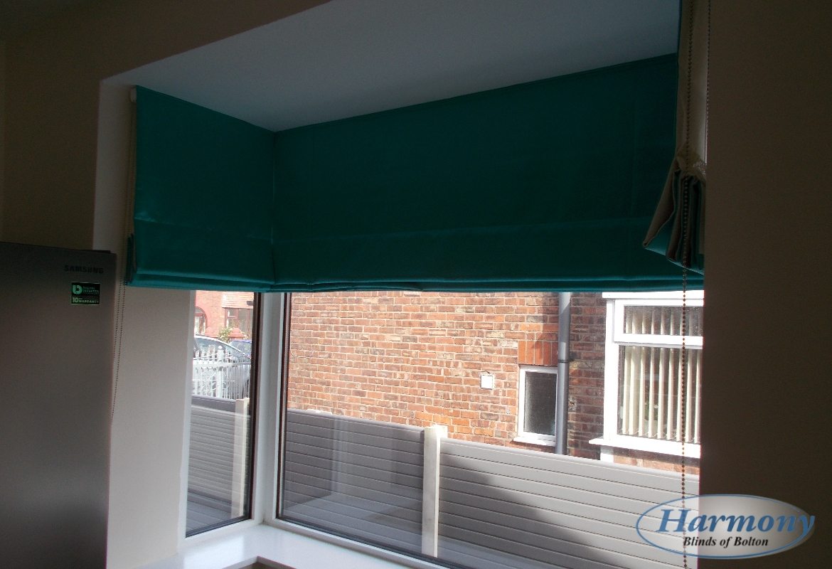 Teal Roman Blinds In A Bay Window Harmony Blinds