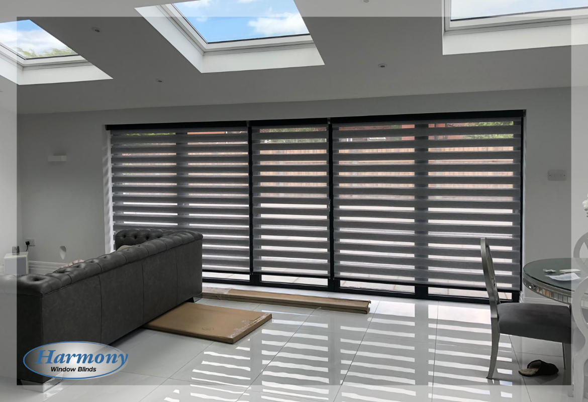 Three Grey Day and Night Blinds on Wide Bi-fold Doors