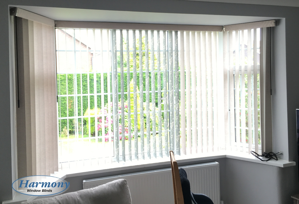 Vertical blinds with pelmets in a bay window