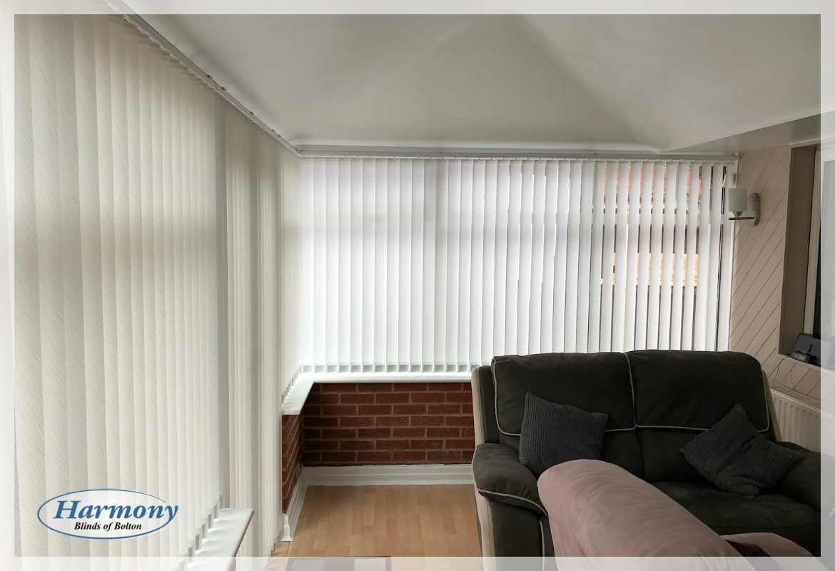White Textured Vertical Blinds in a Conservatory