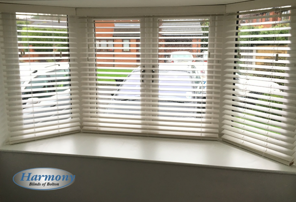 White Wooden Blinds In A Bay Window Harmony Blinds