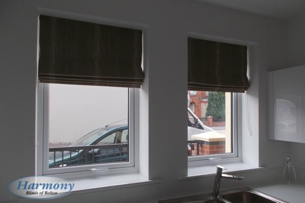A Pair of Brown Roman Blinds in a Kitchen