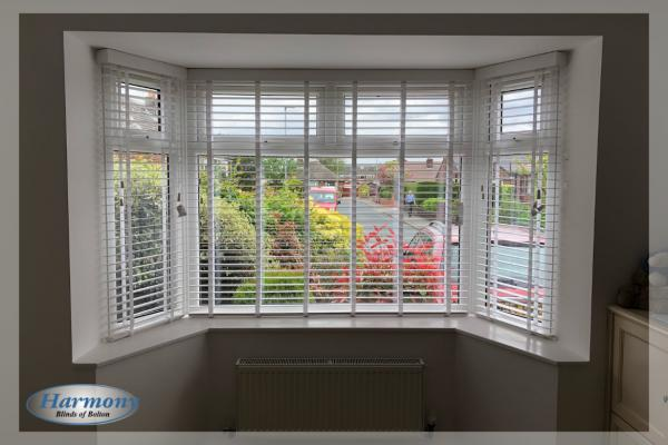 Bay Window with Wooden Blinds with Tapes