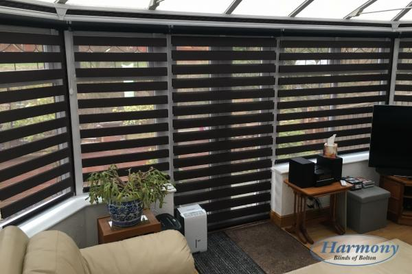 Black Mirage Day and Night Blinds in a Conservatory (Open Position)