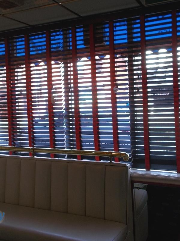 Black Wooden Blinds with striking red ladder tapes
