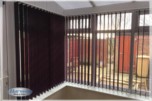 Carnival Grape Vertical Blinds in a Conservatory