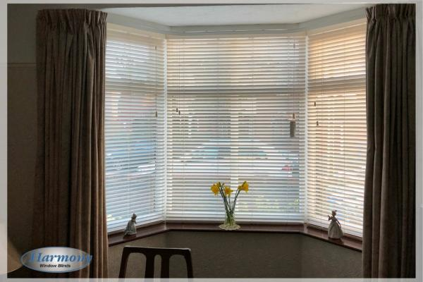 Cool White Wooden Blinds in a Bay Window
