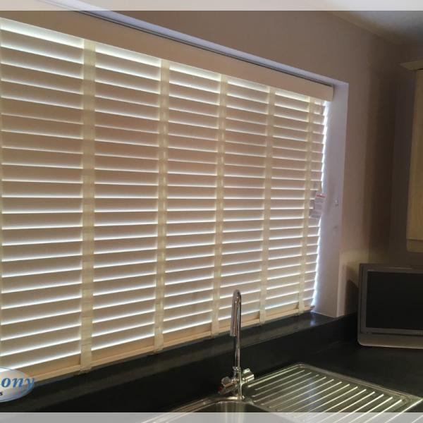Cream Wooden Blinds with matching Tapes in a Kitchen