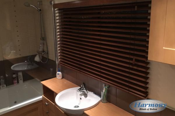 Dark Walnut coloured Wooden Blinds in a Bathroom