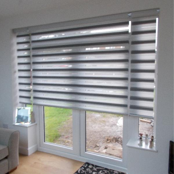 Day & night Mirage Blinds over a 3-panel Door