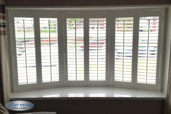 Faux Wood Shutters in a Bay Window