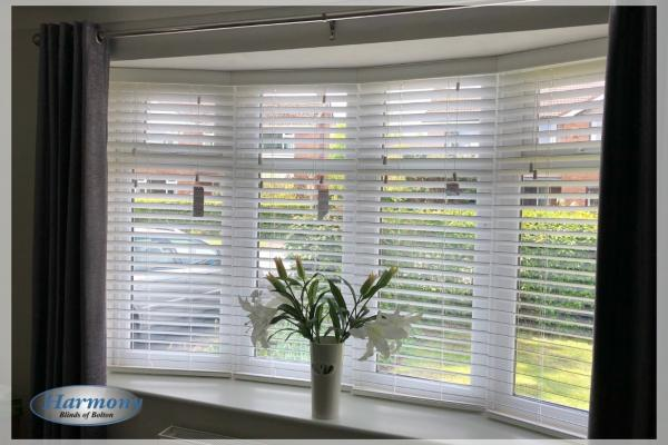 Four Wooden Blinds in a Bay Window