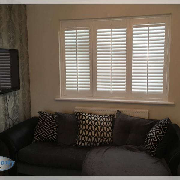 Full Height Shutters in a Living Area