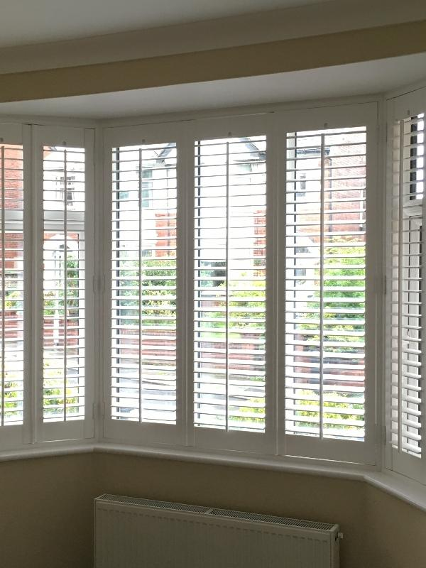 Full Height Shutters in an angled Bay Window