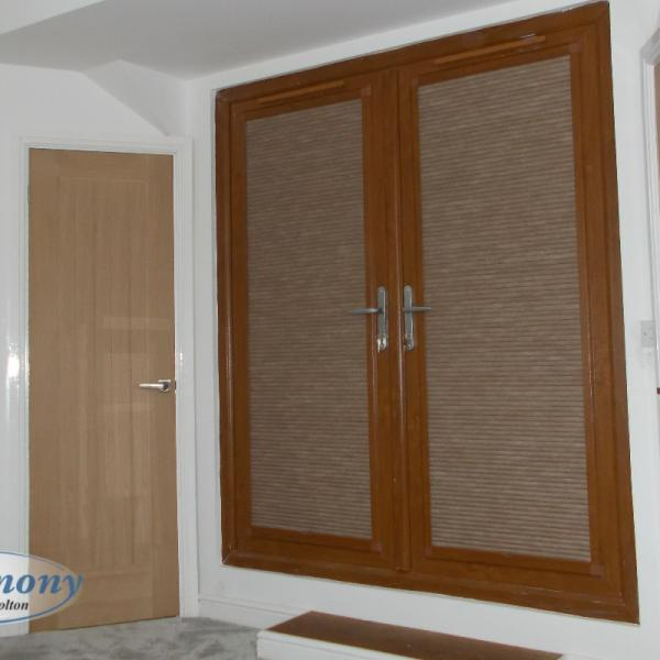 Golden Oak Perfect Fit Pleated Blinds in Bedroom Door Windows