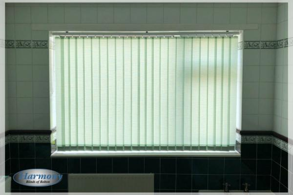 Pale Green Vertical Blind in a Tiled Bathroom