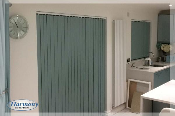 Pastel Green Vertical Blinds on Patio Door and Kitchen