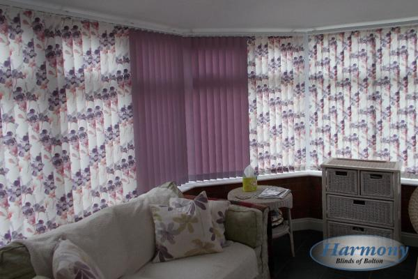 Patterned & Plain Lilac Flower Vertical Blinds in a Conservatory