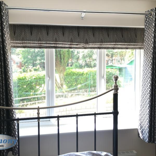 Patterned Roman Blind fitted in a Bedroom