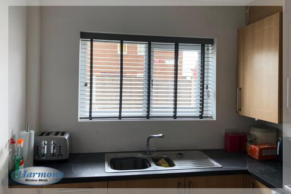 Taped Wooden Venetian Blinds in a Kitchen