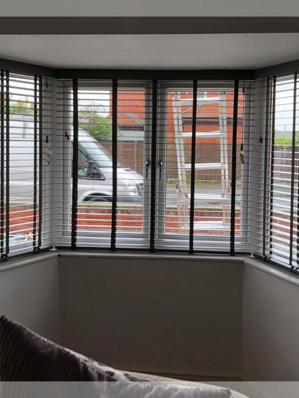 Taped Wooden Venetian Blinds in a Large Bay Window