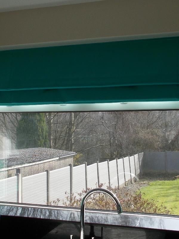 Teal Roman Blind in a Kitchen Window