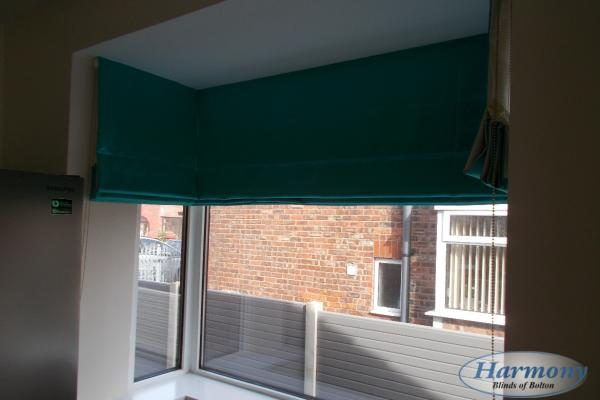 Teal Roman Blinds in a Bay Window