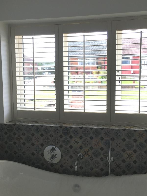 Three Panel PVC Shutters in a Modern Bathroom