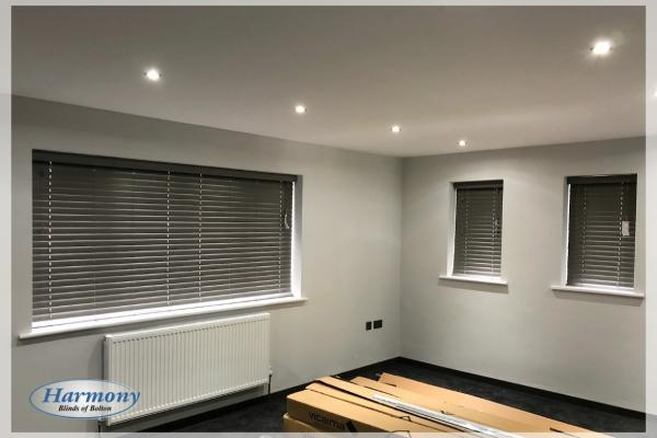 Trio of Grey Wooden Blinds in a Modern Living Area