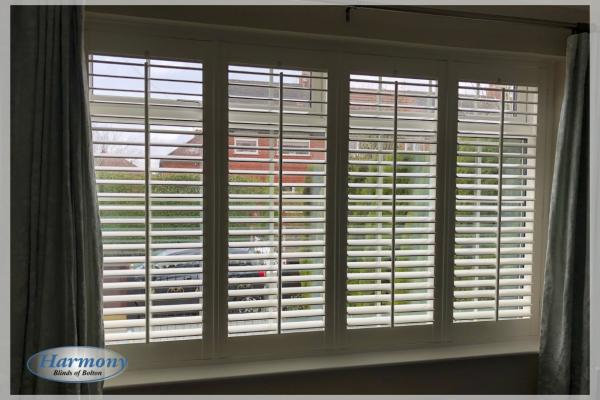 Vivid White Full Height Shutters in wide window
