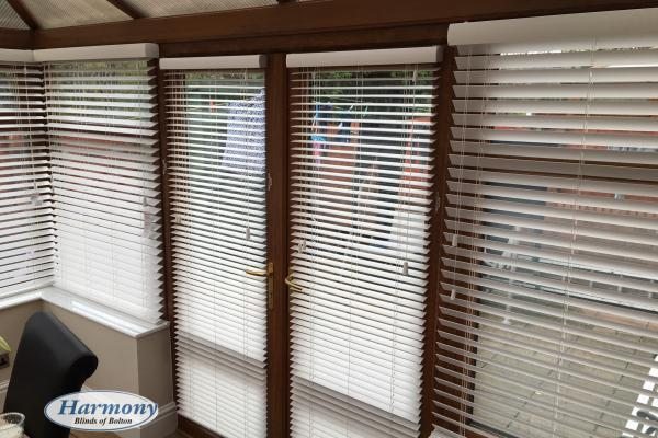 White Faux Wood Blinds in a Golden Oak Conservatory