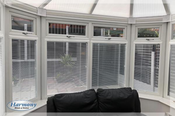 White Perfect Fit Venetian Blinds in a Conservatory