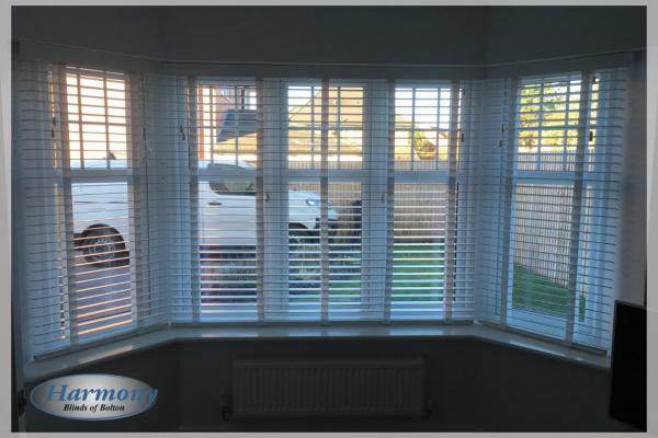 White Real Wood Blinds with matching Cotton Tapes in a Bay Window