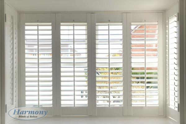 White Shutters in a Square Bay Window
