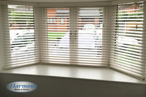 White Wooden Blinds in a Bay Window