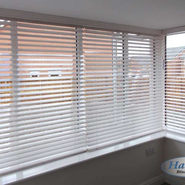 White Wooden Blinds in a Square Bay Window