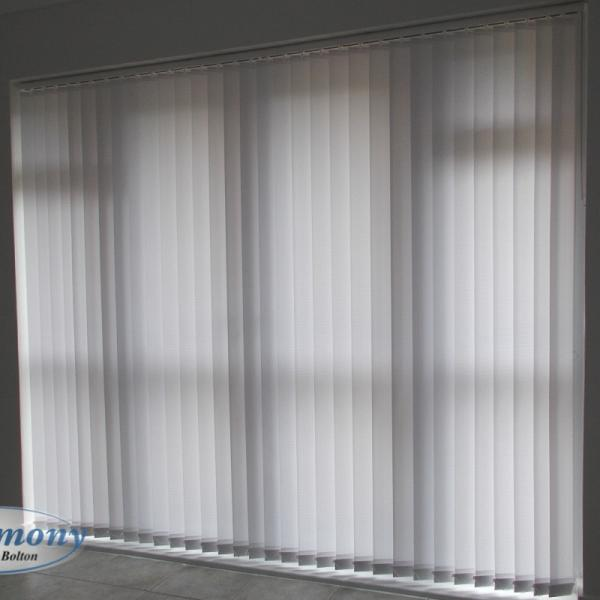Wide Textured Vertical Blind over a Patio Door