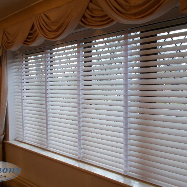 Wide White Wooden Blind with tapes to accompany swags and tails curtains